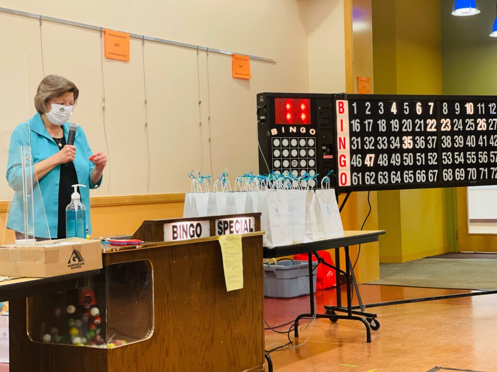 Woman Wearing Blue Calling Out Bingo Numbers